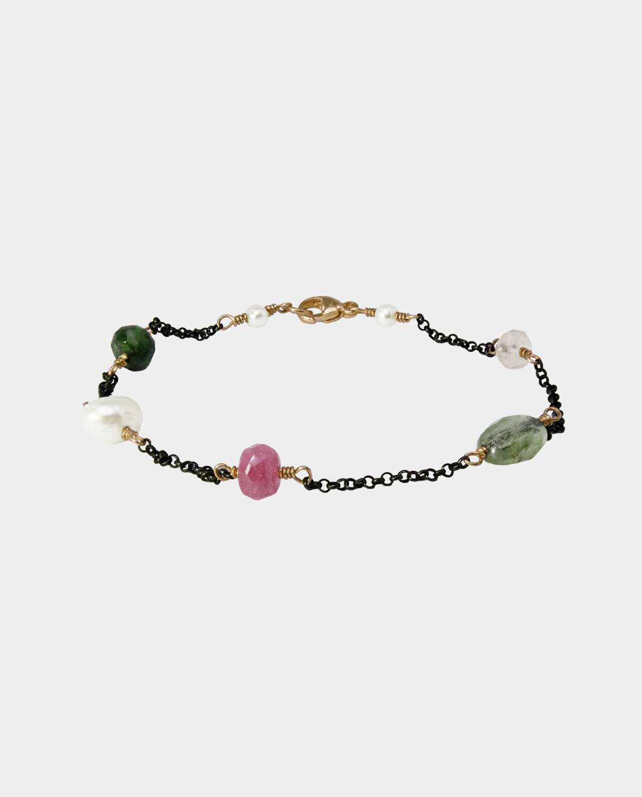 Handmade bracelet with tourmaline, garnet and freshwater pearl that creates a spectrum of color and gives your look a touch of elegance