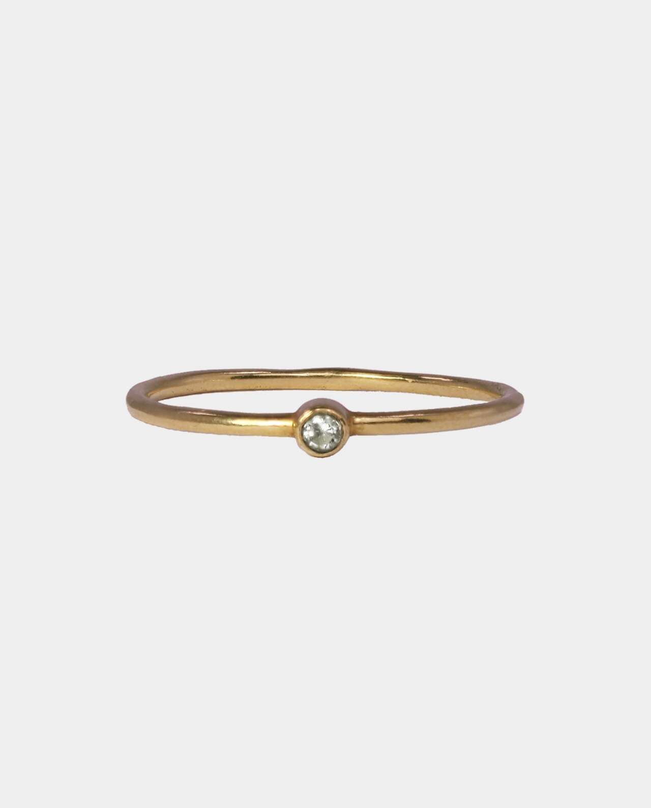 Gilded vintage ring with zircon and charming bumps that lead thoughts back to the royal tombs of history