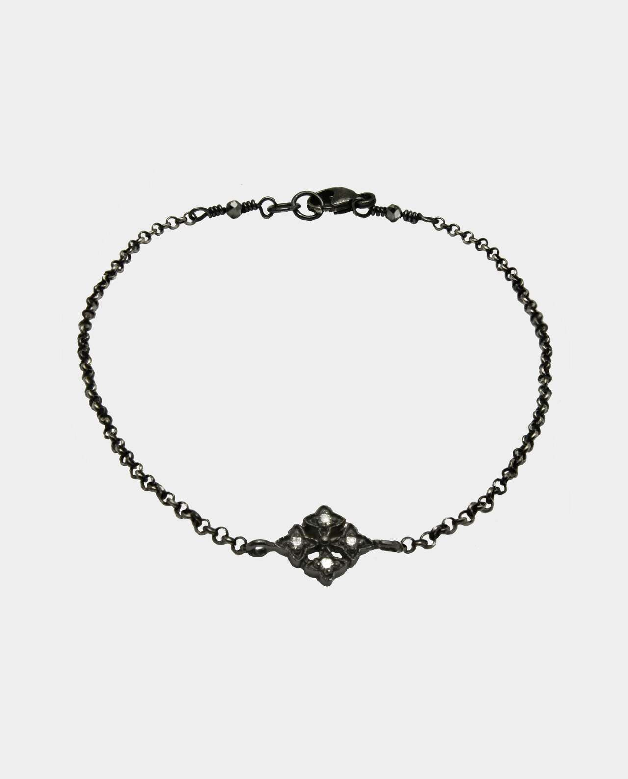 Zirconia that sparkles throughout the color spectrum on black chain of oxidized sterling silver and has a compelling effect