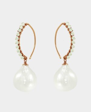 Handmade earrings adorned with bevelled peridots with a droplet-shaped white freshwater pearl that makes the popular jewels modern