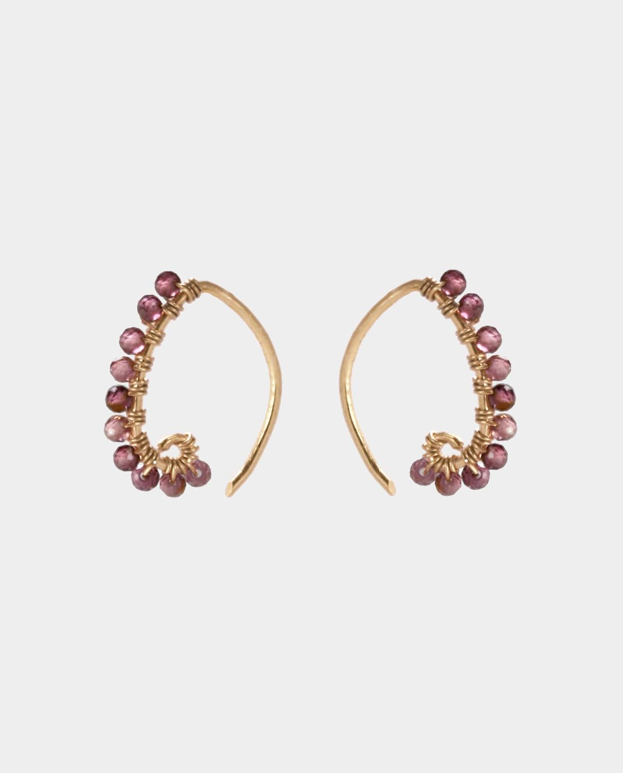 Small curved ear hooks plated with 18 carat gold and with bevelled garnets in a line