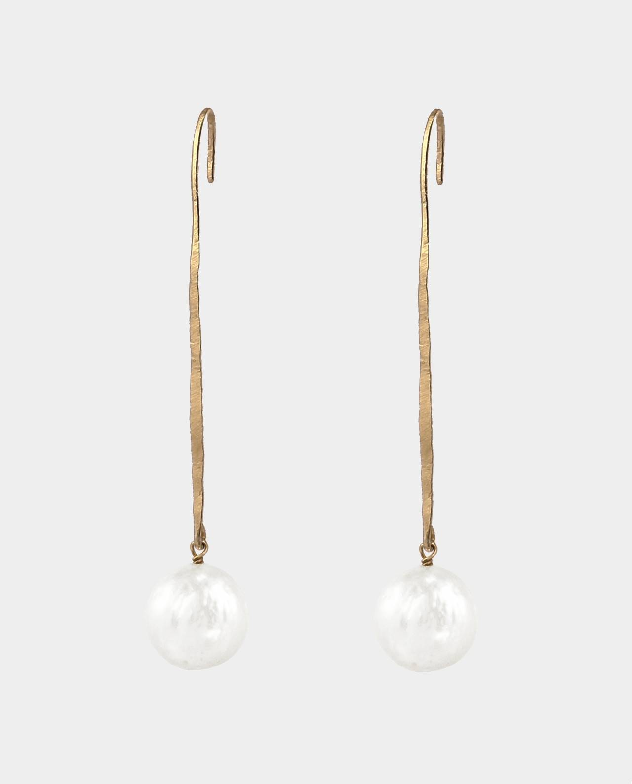 Original jewelry art in the shape of long hammered earstuds with round white pearls inspired by the jewelers of antiquity