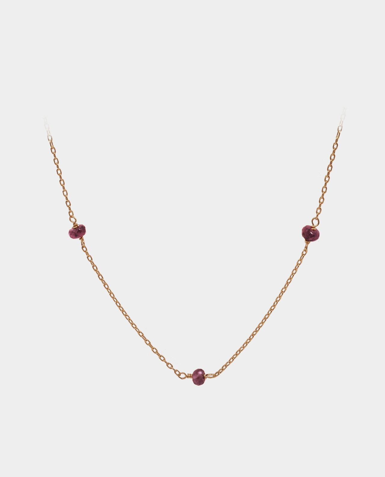 Necklace with pink sapphires in vintage design bevelled according to the original method