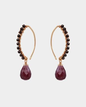 Earrings with droplet-shaped rubies and black spinel on curved ear hook of sterling silver plated with 18 carat gold