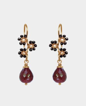 Earrings with bevelled rubies with droplet shapes and flowers decorated from black spinel gemstones on sterling silver plated with 18 carat gold without nickel