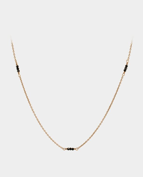 Handmade necklace with black spinel designed to fall gracefully around your neck with chain of sterling silver plated with 18 carat gold without nickel