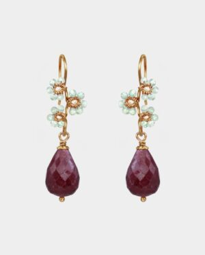 Handmade earrings with large droplet-shaped rubies and flowers creatively shaped in green amethysts