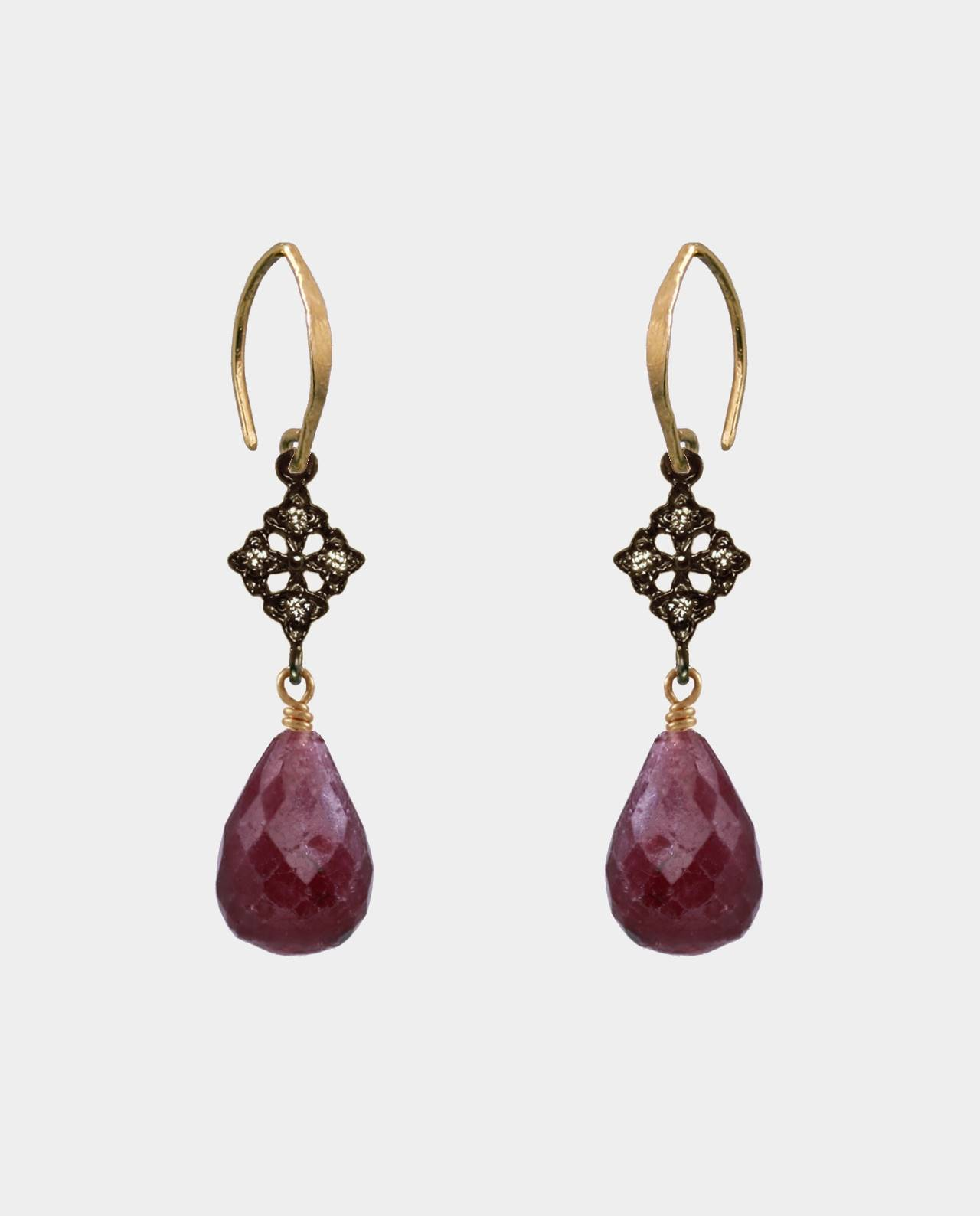 Handmade earrings with large droplet-shaped rubies and zirconia and rustic oval ear hooks in sterling silver plated with 18 carat gold