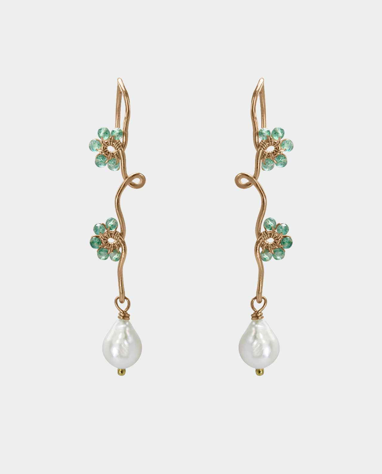 Organically designed earring with green onyx and white freshwater pearls in its own beautiful story so the piece of jewelry becomes a tribute to women who adorn themselves with natural gemstones and hand-made jewels