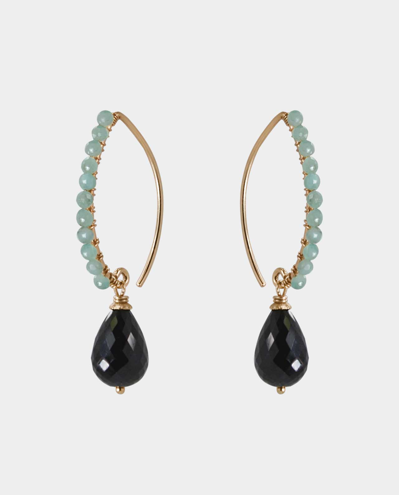 Elegant handmade earrings with light green emeralds and black onyx as stylish jewels of gold that make you look like a queen and highlight your inner beauty and sense of feminine aesthetics