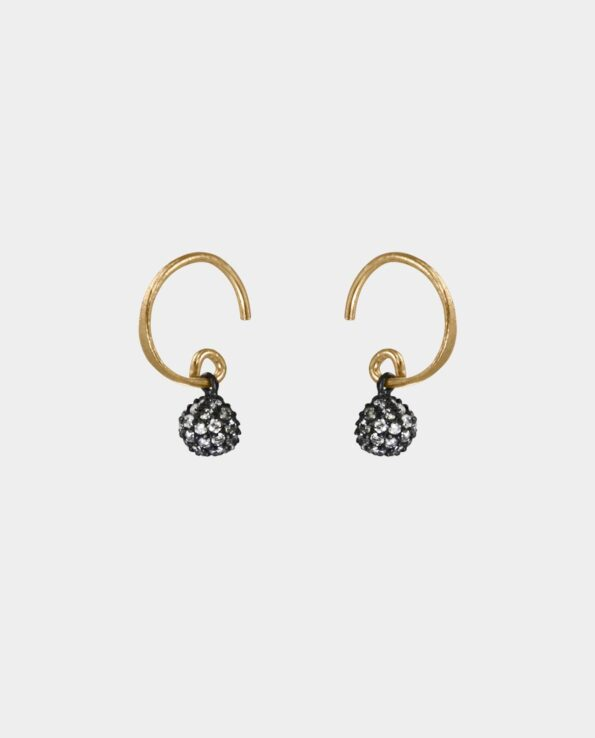 Handmade earrings with hammered ear hooks and rustic pendants in oxidized sterling silver that are perfect for the modern woman and the bride who is getting married as the jewelry highlights the beauty of the earrings' discreet and refined balance