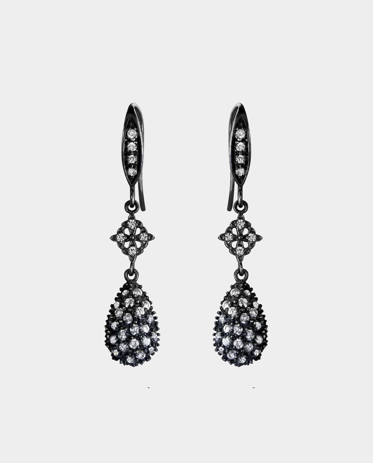 Earrings in oxidized sterling silver adorned with dozens of sparkling zirconias highlight your beautiful look without the use of superfluous ornamentation which adds a subtle touch of class