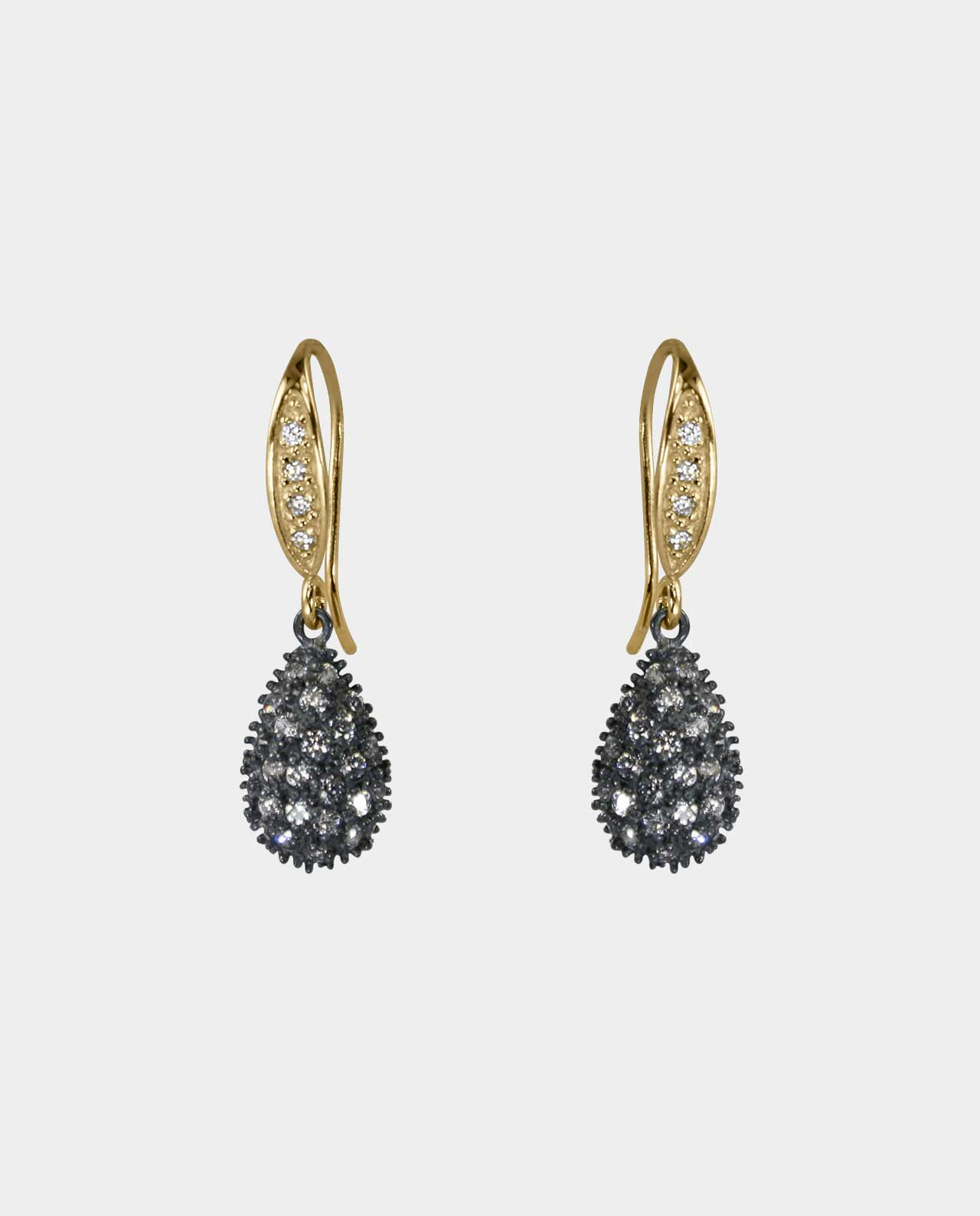 Feminine earrings with zirconia and rustic oxidized sterling silver that shines in light in the form of a classic piece of jewelry processed by hand giving the earrings an organic expression with real gold and gemstones