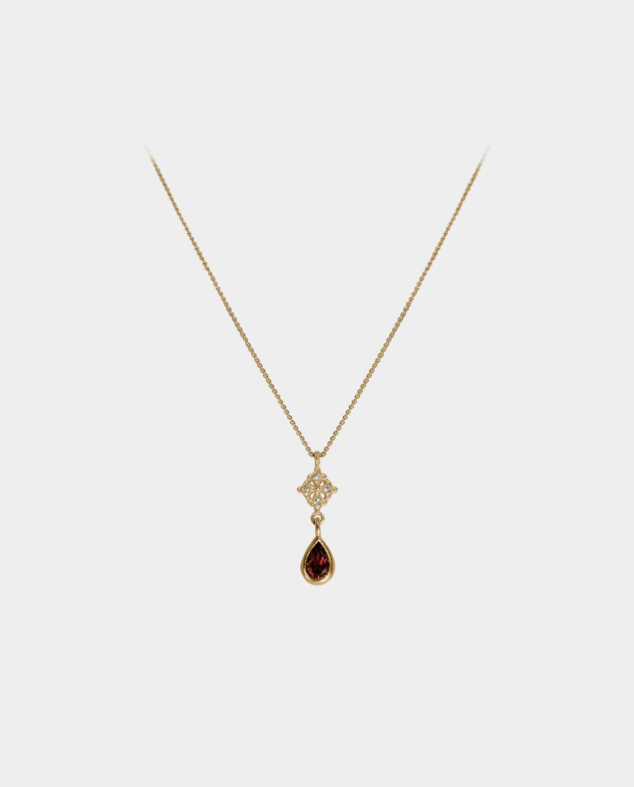 Handmade necklace accentuated by beautiful zirconia in a pendant and a red garnet with elegant setting that has an artistic retro expression for the aesthetic and quality-conscious woman