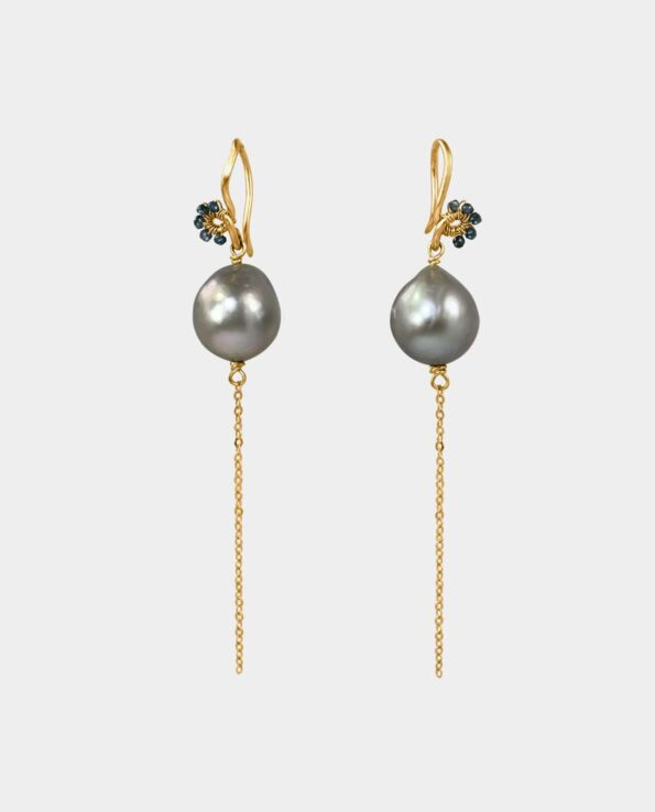 Artistic earrings with blue diamonds and dark pearl and chain of gold sold in Copenhagen