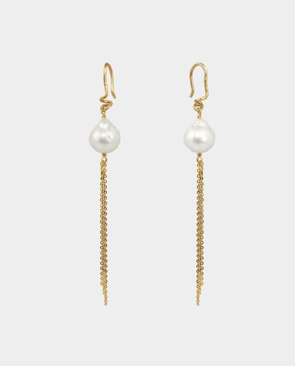 handmade organic earrings with artistic expression of gold with chains and white pearls as a luxury gift in Copenhagen