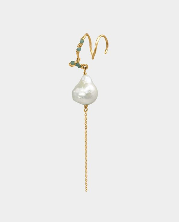 Artistic earring with baroque white pearl and light green emeralds in tasteful modern jewelry design from the jewelry store in Copenhagen