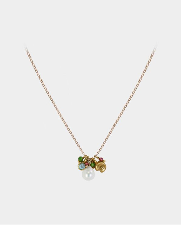 Necklace with a collection of blue and green aventurin, garnet, white pearl and a pendant with snail motif from the jewelry store in Kbh K