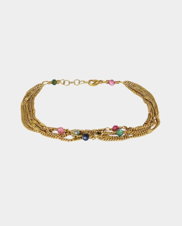 Bracelets with many gold-plated chains in layer-on-layer and multi-coloured tourmalines from the inner city jewelry store