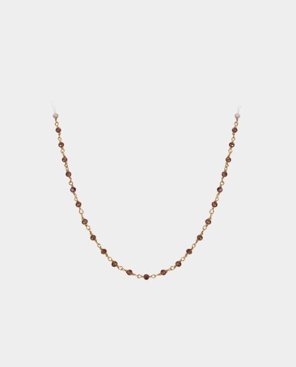 This lovely necklace is adorned with dozens of small red garnets that make the piece appear as an indispensable ornamental object for women who love to adorn themselves with the finest gemstones