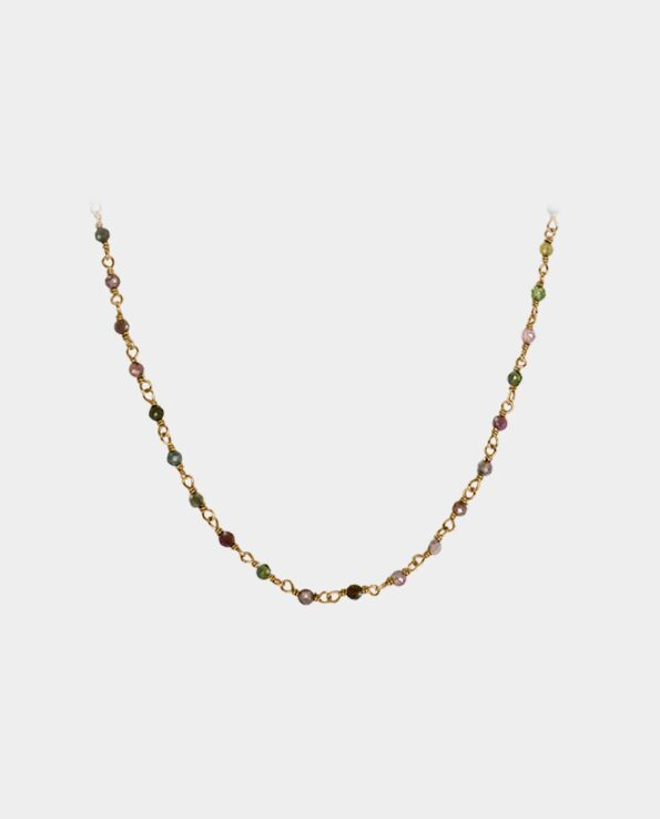 Exquisite necklace with many tourmalines in several different colors that look adorable when the jewelry lays around a woman's neck like a necklace with gemstones that appears like a divine touch of paradise