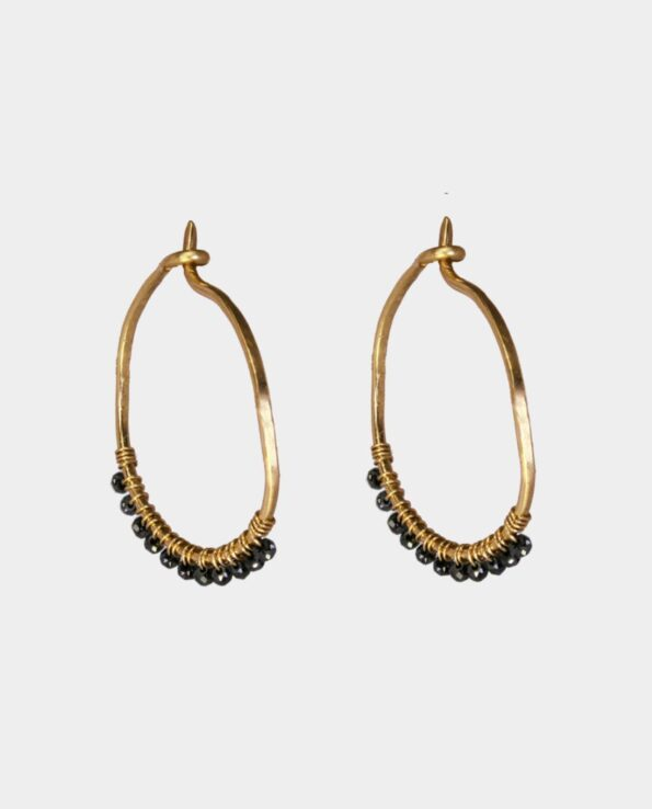 Organic hoops with small black diamonds in original design sold in jewelry store in the centre of Copenhagen