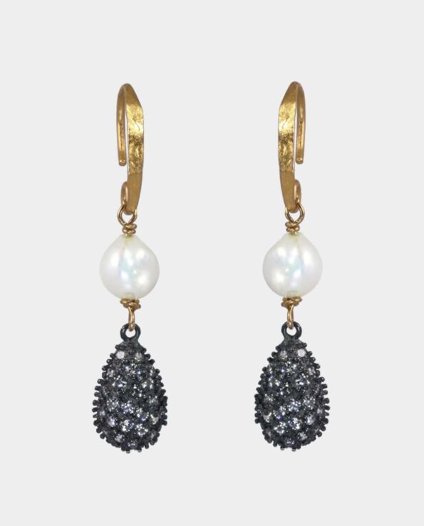 Classic earring in Copenhagen with raw processed black silver and antique ear hooks with white pearl - a piece of jewelry that has patina