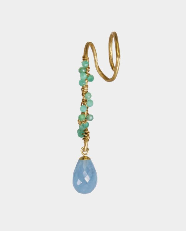 Artistically designed earring with aquamarine and twenty small emeralds from the jewelry store in Copenhagen