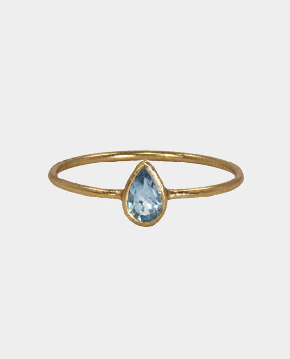 Ring with drop-shaped light blue topaz in classic entsal - the perfect gift for the woman who loves jewellery and can be bought on sale at the jewellery store in the centre of Copenhagen